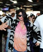 th 185387500 SG6 122 457lo Selena Gomez *BRA SLIP*, arriving at an airport in Buenos Aires   10/2/12