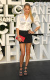 Anna Kournikova shows her long legs in black mini skirt and give a peek at her black bra under white blouse at Chanel 2008/09 Cruise Show in Miami
